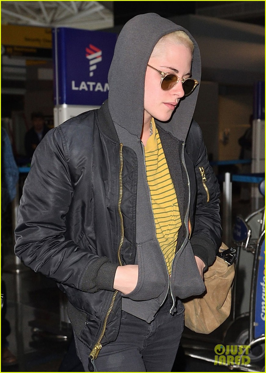 kristen stewart covers up new buzzed hair arriving in nyc 04