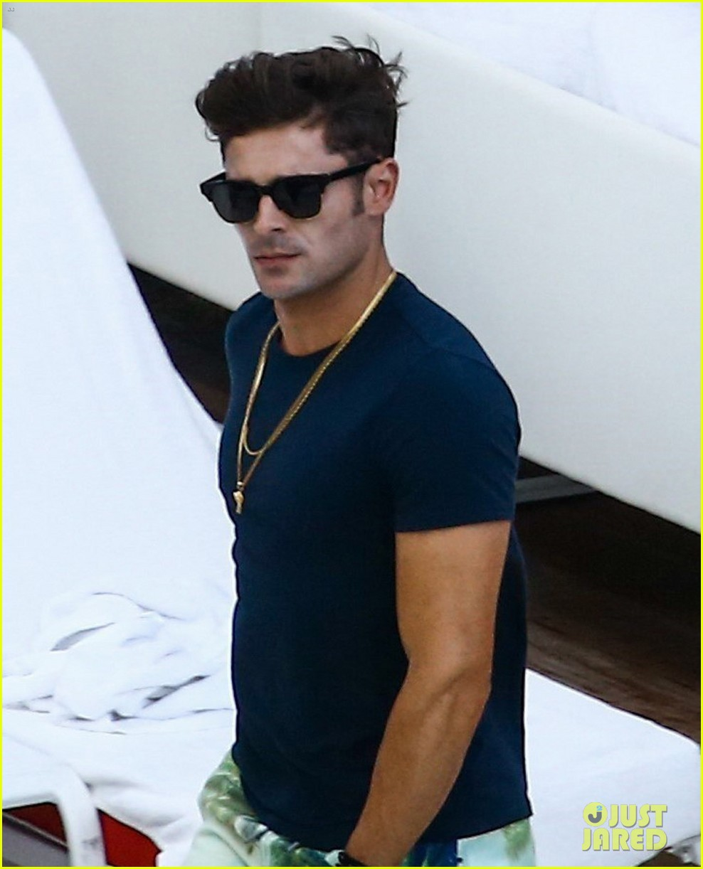zac efron alexandra daddario hang out poolside in miami 04