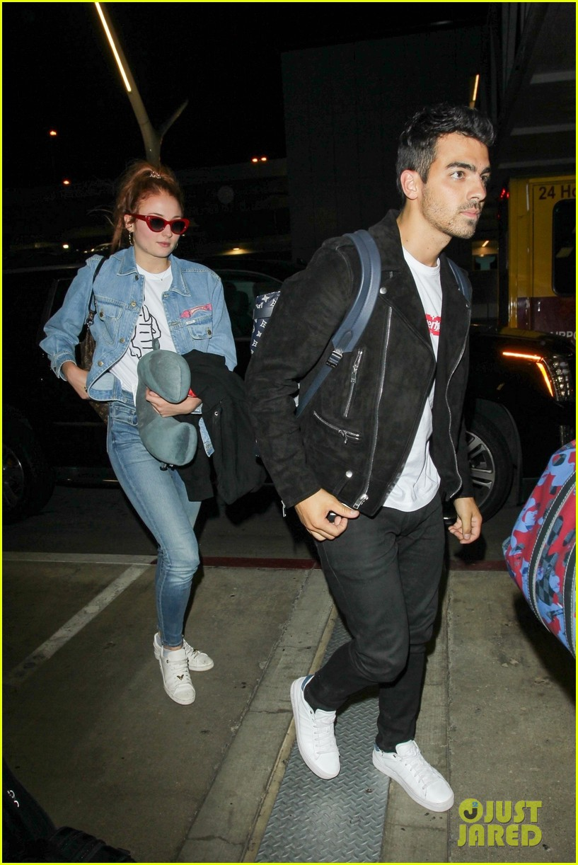 sophie turner reps joe jonas on her jacket at lax 02