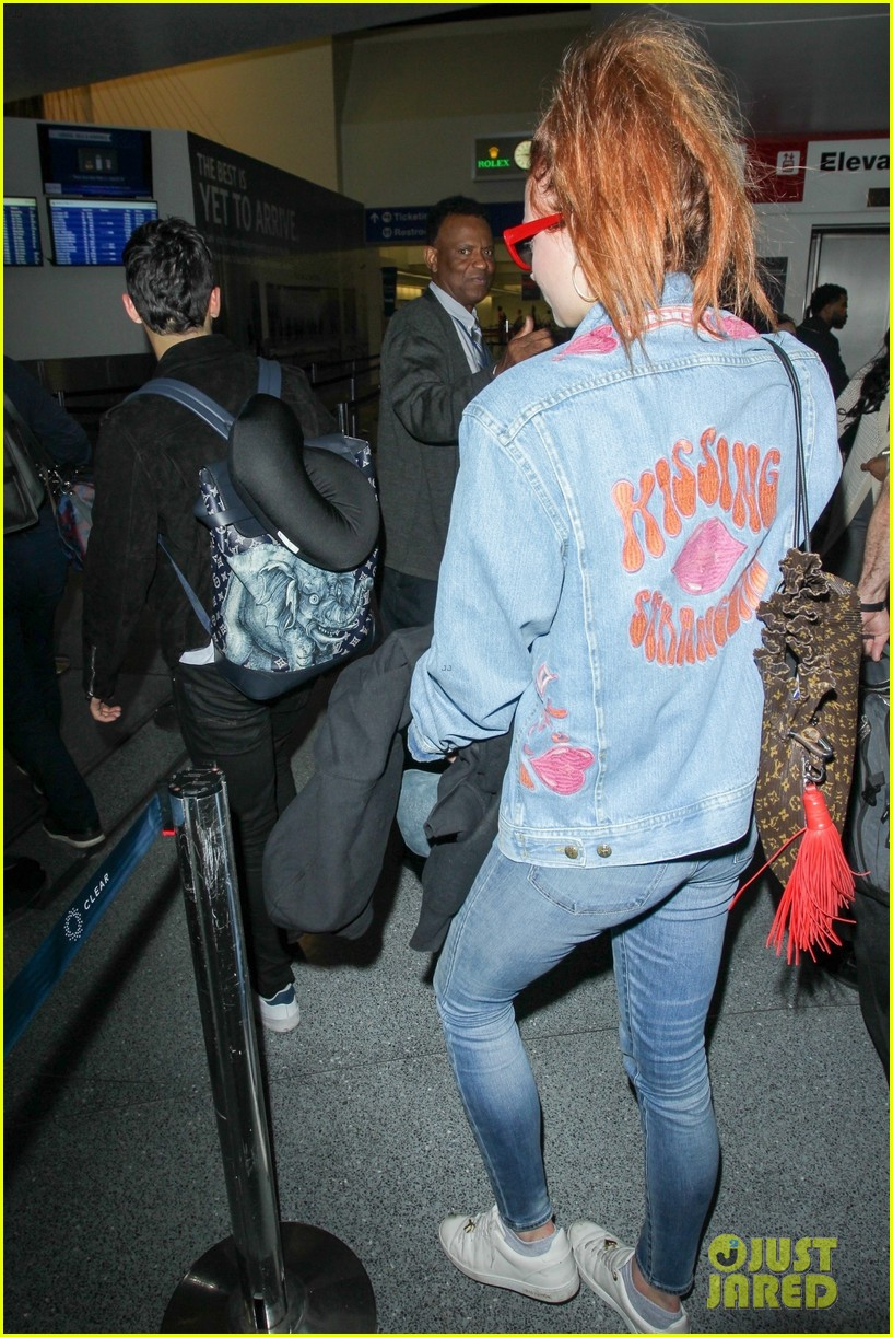 sophie turner reps joe jonas on her jacket at lax 10