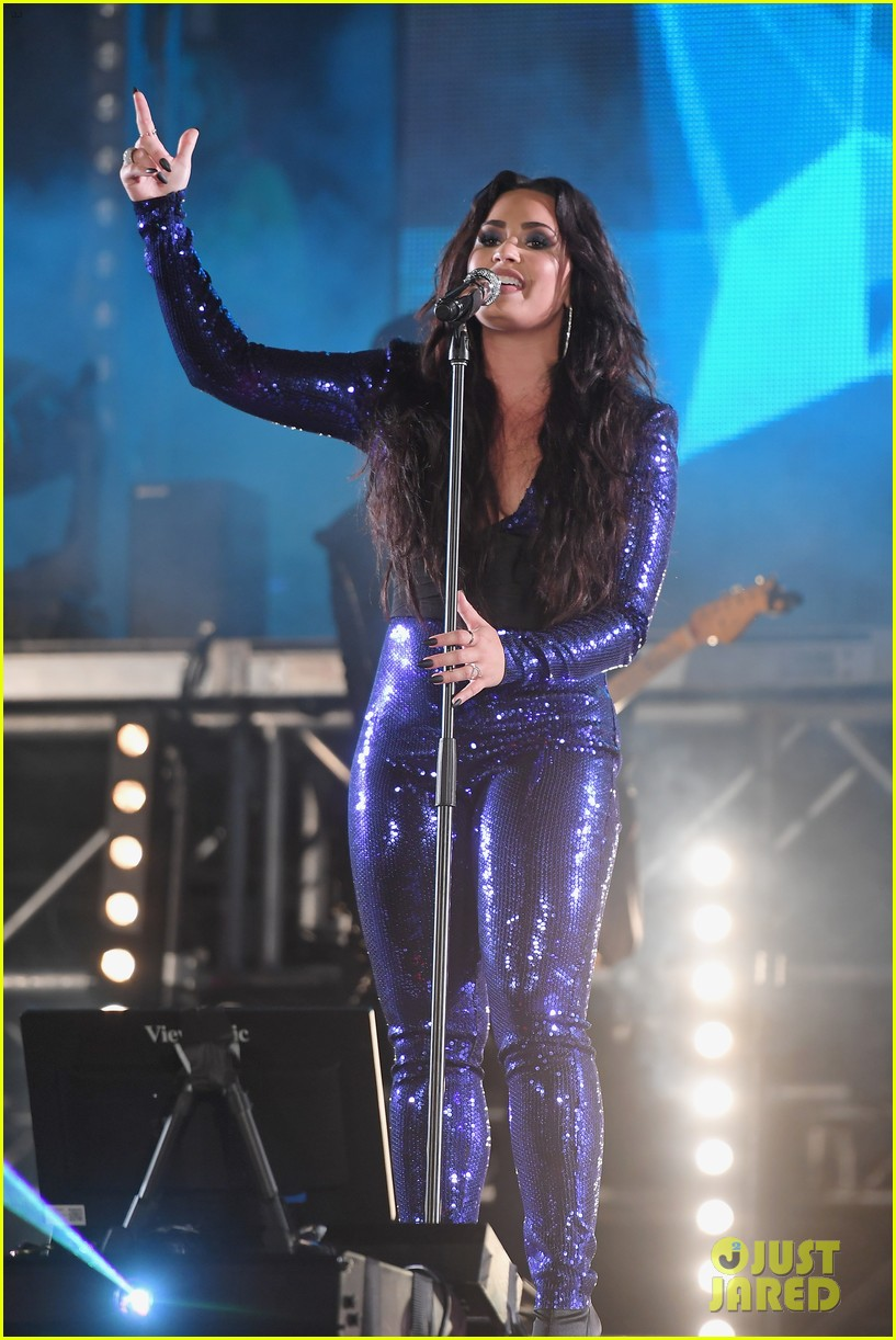 demi lovato performs in a sequined jumpsuit for nye in miami 03